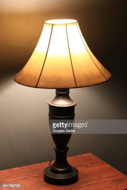 Close-Up Of Illuminated Lamp on a table At Home