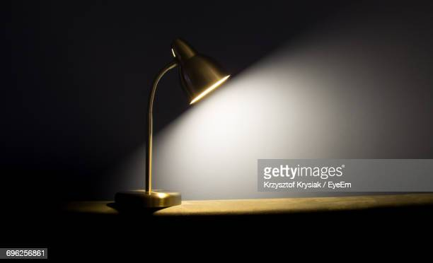 close-up of illuminated lamp - electric lamp stock photos and pictures