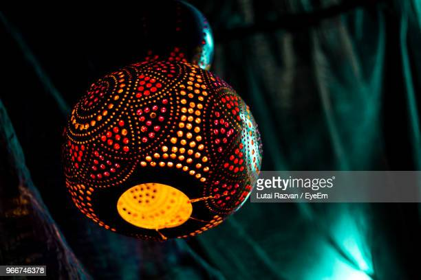close-up of illuminated lantern hanging from ceiling - lutai razvan stock pictures, royalty-free photos & images