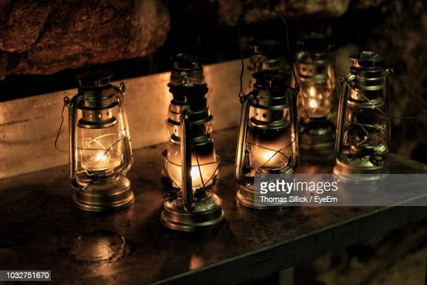 close-up of illuminated lanterns on table - oil lamp stock pictures, royalty-free photos & images