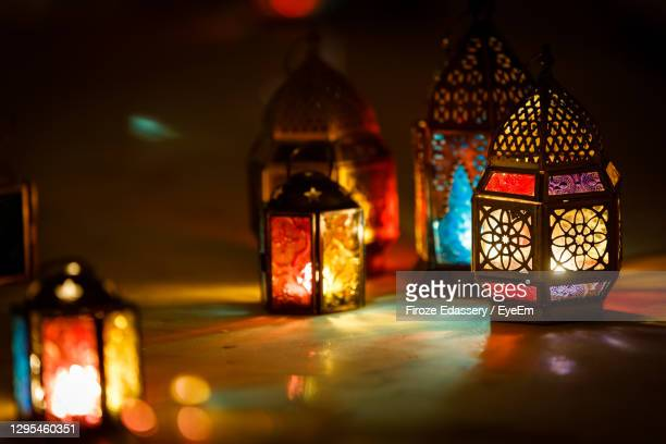 close-up of illuminated lanterns on table - ramadan stock pictures, royalty-free photos & images