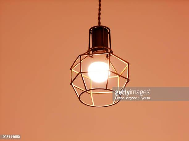 close-up of illuminated light bulb against colored background - fedor stock pictures, royalty-free photos & images