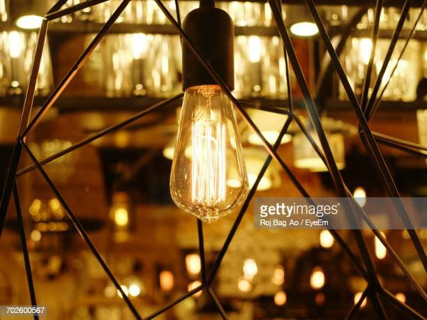 Close-Up Of Illuminated Light Bulb In Lantern At Event
