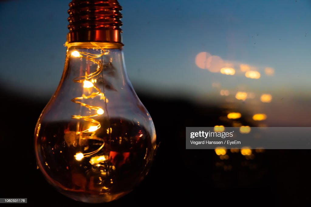 Close-Up Of Illuminated Light Bulb : Stock Photo