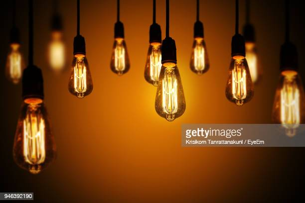 close-up of illuminated light bulbs - light bulb stock pictures, royalty-free photos & images