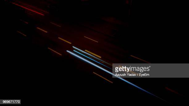 close-up of illuminated light trails against black background - light trail stock pictures, royalty-free photos & images