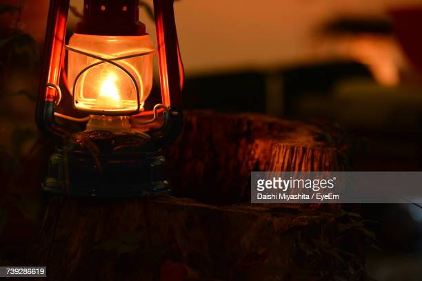 close-up of illuminated lighting equipment - oil lamp stock pictures, royalty-free photos & images