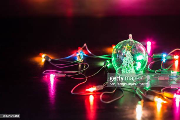 close-up of illuminated lighting equipment - christmas garland stock pictures, royalty-free photos & images