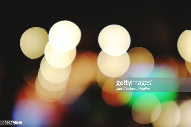 close-up of illuminated lights - lens flare stock pictures, royalty-free photos & images