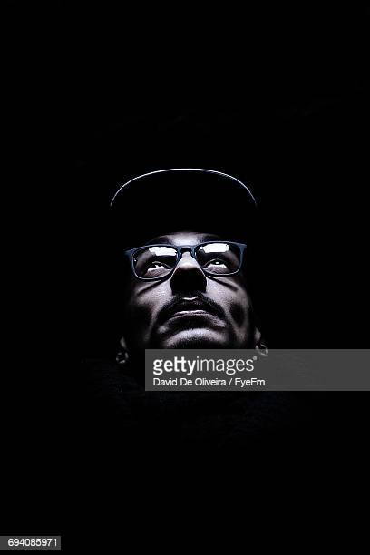 close-up of illuminated mans face - reading glasses stock pictures, royalty-free photos & images