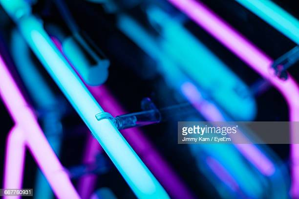 close-up of illuminated neon lights - fluorescent light stock pictures, royalty-free photos & images