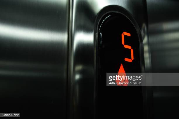 close-up of illuminated number 5 sign in elevator - number 5 stock pictures, royalty-free photos & images