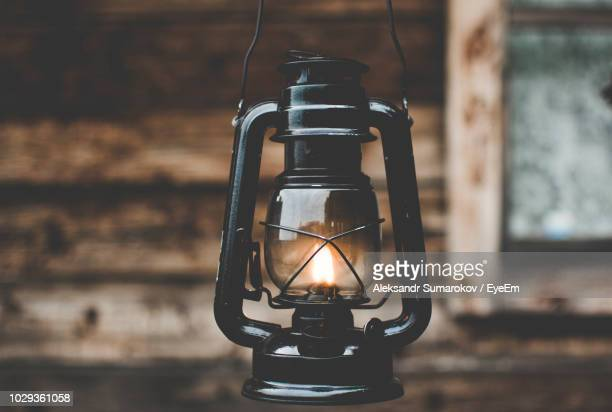 Close-Up Of Illuminated Oil Lamp Hanging Outdoors