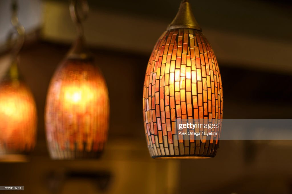 Closeup Of Illuminated Pendant Lights At Home Stock Photo   Getty Images