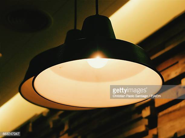 Close-Up Of Illuminated Pendant Lights In House