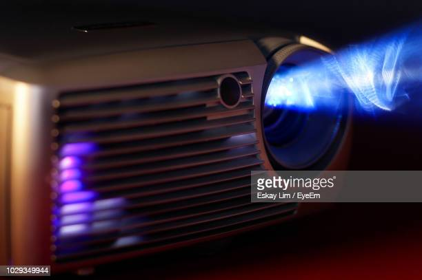 close-up of illuminated projector - projection equipment stock pictures, royalty-free photos & images