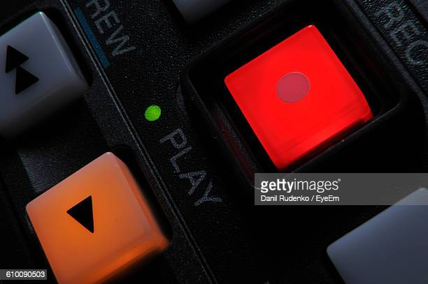 close-up of illuminated record and play button - play button stock photos and pictures