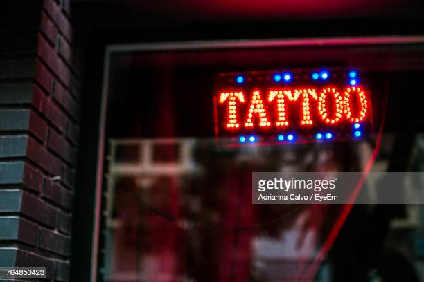 close-up of illuminated red lights - tattoo stockfoto's en -beelden