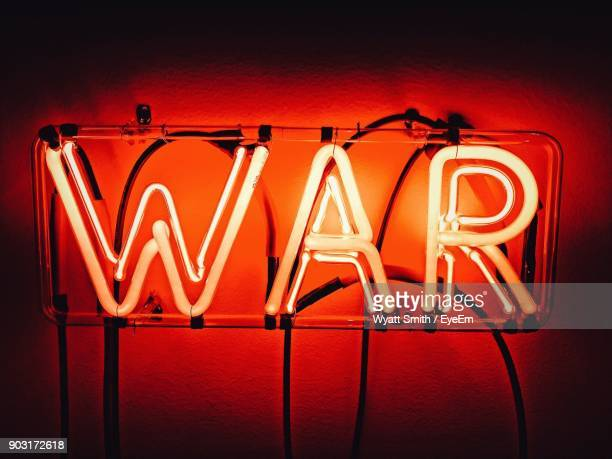close-up of illuminated red neon sign - neon letters stock photos and pictures