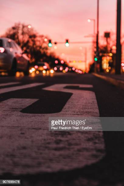 Close-Up Of Illuminated Road During Sunset