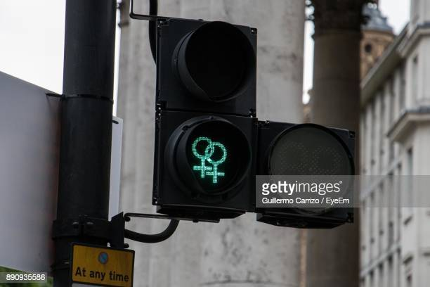 Close-Up Of Illuminated Road Signal In City