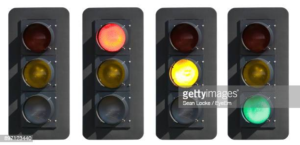 close-up of illuminated road signal - road signal stock pictures, royalty-free photos & images