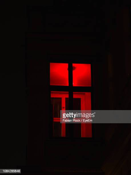 close-up of illuminated sign in darkroom - red light district stock pictures, royalty-free photos & images