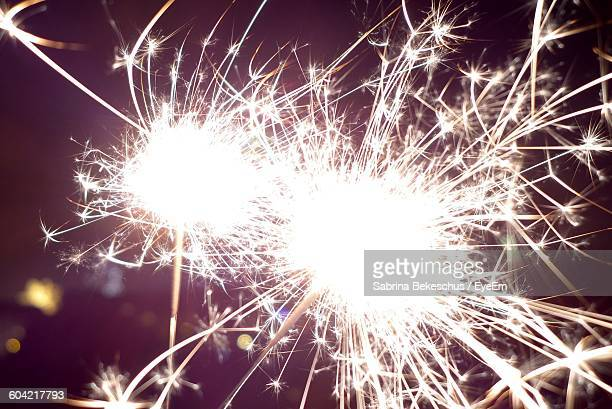 Close-Up Of Illuminated Sparklers At Night