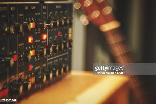 close-up of illuminated synthesizer in recording studio - electronic music stock pictures, royalty-free photos & images