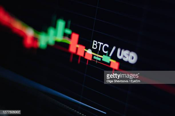 close-up of illuminated text against black background - bitcoin stock pictures, royalty-free photos & images