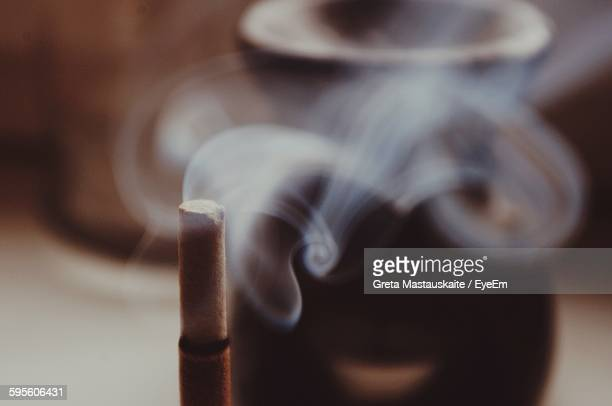 close-up of incense burning in temple - incense stock photos and pictures