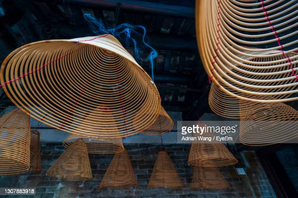 close-up of incense in a temple - incense coils stock pictures, royalty-free photos & images