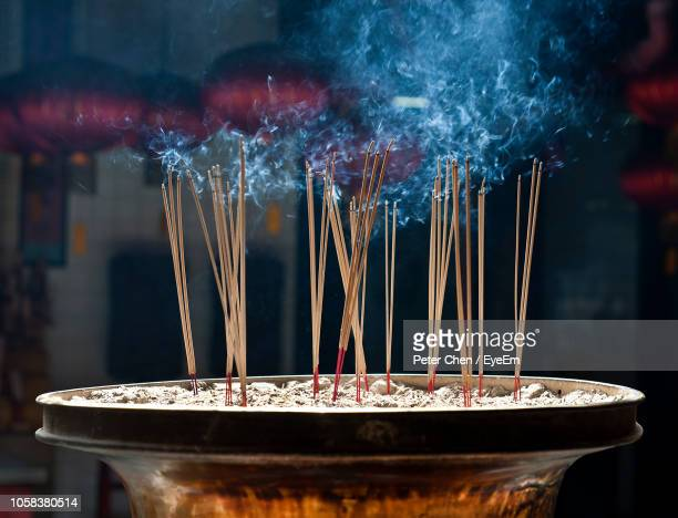 close-up of incense in temple - incense stock photos and pictures
