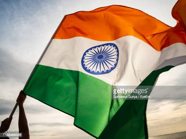 close-up of indian flag against sky - indian flag stock pictures, royalty-free photos & images