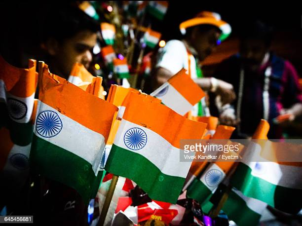 close-up of indian flag models for sale at market - indian flag stock pictures, royalty-free photos & images