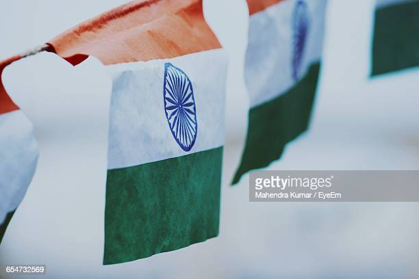 Close-Up Of Indian Flags Against Sky
