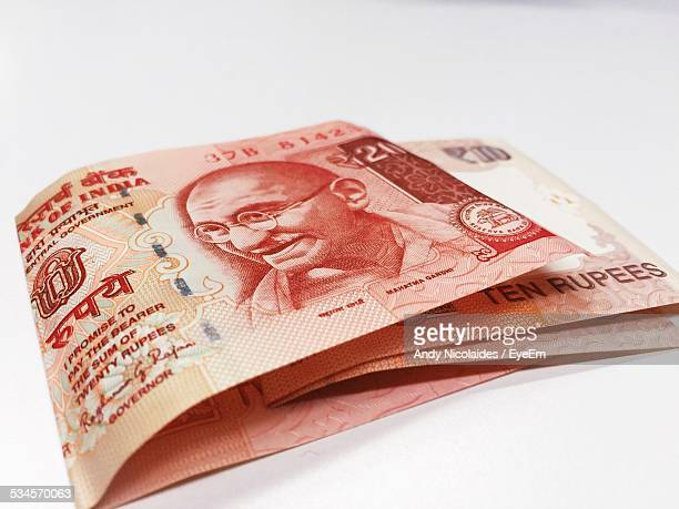 Close-Up Of Indian Paper Currency On Table