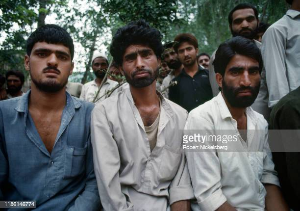 Close-up of Indian-Kashmiri men in a militant training camp that houses 17-30 year-old men, near Muzzafarbad, Pakistan, October 1, 1991.
