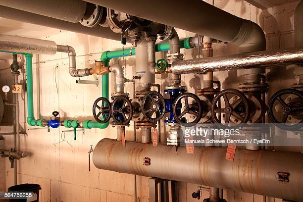 close-up of industrial pipelines - air valve stock photos and pictures