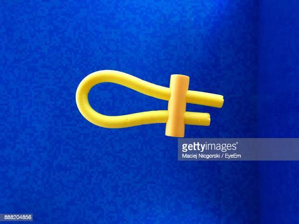 Close-Up Of Inflatable Ring Against Blue Background