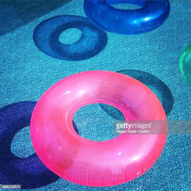Close-Up Of Inflatable Rings In Swimming Pool