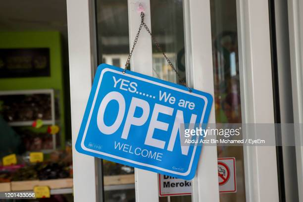 close-up of information sign on door - open for business stock pictures, royalty-free photos & images