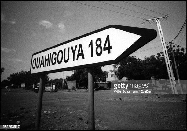 close-up of information sign on field - ouagadougou stock pictures, royalty-free photos & images