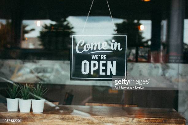 close-up of information sign on glass window at restaurant - open stock pictures, royalty-free photos & images