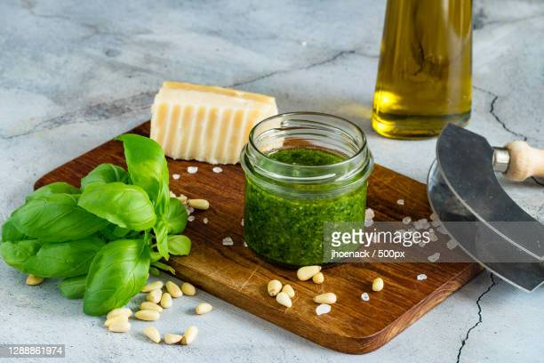 close-up of ingredients on cutting board - pesto stock pictures, royalty-free photos & images