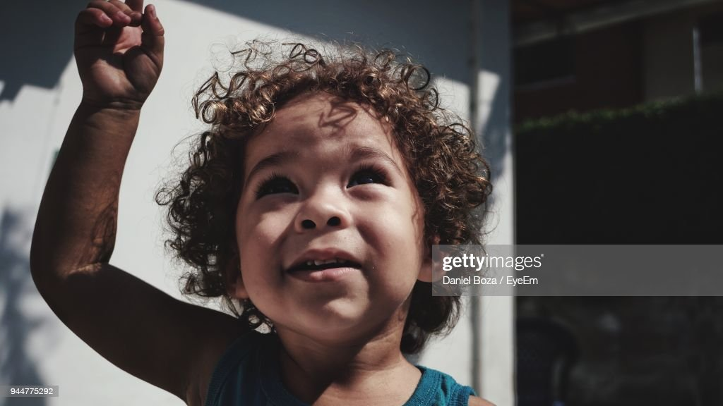 Close-Up Of Innocent Boy Looking Up : Stock Photo
