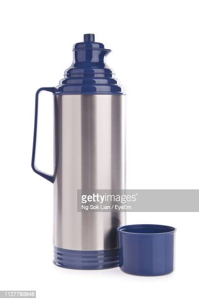 close-up of insulated drink container against white background - flask stock pictures, royalty-free photos & images