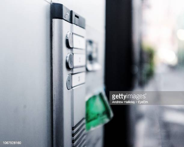 close-up of intercom on wall - intercom stock pictures, royalty-free photos & images