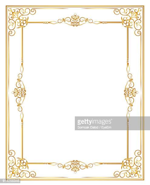 Close-Up Of Invitation Card Over White Background