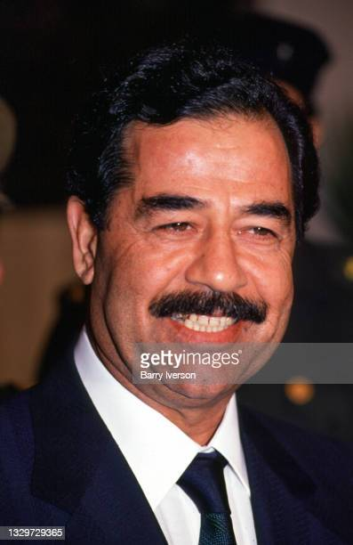 Close-up of Iraqi President Saddam Hussein as he speaks to the press at Cairo Airport, Cairo, Egypt, November 28, 1988. He was preparing to return to...